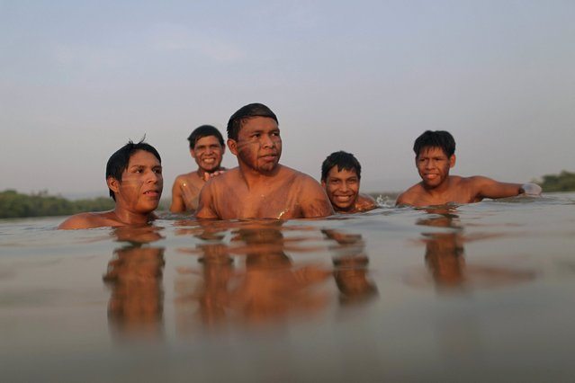 Indigenous people from the Guarani Kaiowa tribe are seen in Tocantins river before the I World Games for Indigenous People in Palmas, Brazil, October 21, 2015. (Photo by Ueslei Marcelino/Reuters)
