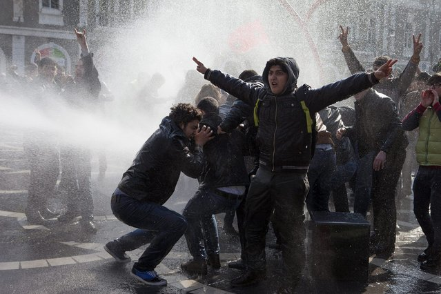 Policemen use water cannons to break up the crowd of protesters during a rally in Baku, March 10, 2013. Police in Azerbaijan fired rubber bullets and water cannon at hundreds of opposition protesters demonstrating on Sunday against violence in the military in the oil-rich country. (Photo by Elmar Mustafazadeh/Reuters)