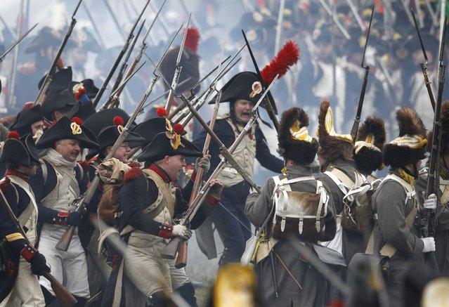 History enthusiasts dressed in regimental costumes take part in a  re-enactment of Napoleon's famous battle of Austerlitz, celebrating its 209. anniversary, near Slavkov u Brna, Czech Republic, Saturday, November 29, 2014. (Photo by Petr David Josek/AP Photo)