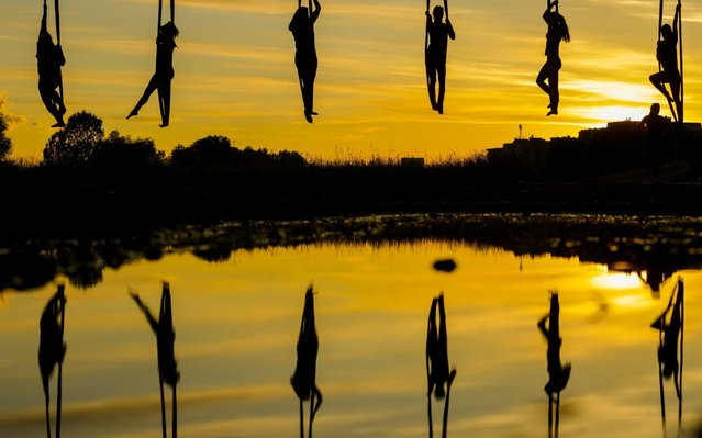 Members of Triko Circus Theater perform aerial hammock dance by hanging from the Mladost Bridge over Sava River in Zagreb, Croatia, on June 11, 2020. (Photo by Xinhua News Agency/Rex Features/Shutterstock)