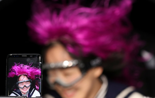 A woman checks Samsung's Galaxy S9+ slow-motion video inside its booth at theg the Mobile World Congress in Barcelona, Spain, February 27, 2018. (Photo by Yves Herman/Reuters)
