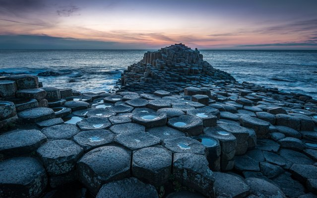 The basalt columns and mood grey sea located at Belfast's Giants Causeway looks like a set from Game of Thrones. (Photo by Greg Sinclair/500px)