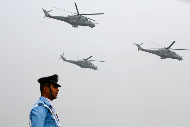 An Indian Air Force soldier marches as Mil Mi-35 helicopters fly over during the full-dress rehearsal for Indian Air Force Day at the Hindon air force station on the outskirts of New Delhi, India, October 6, 2016. (Photo by Adnan Abidi/Reuters)