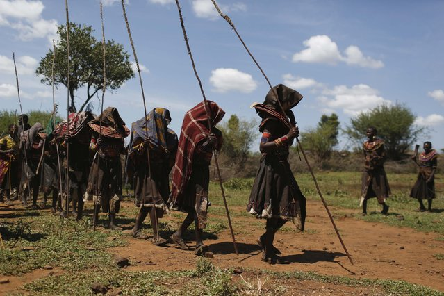 Pokot girls walk in line during an initiation ceremony of over a hundred girls passing over into womanhood, about 80 km (50 miles) from the town of Marigat in Baringo County December 6, 2014. (Photo by Siegfried Modola/Reuters)