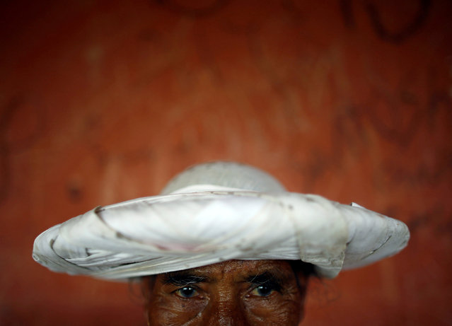 A priest in traditional attire takes part during of the Shikali festival at Khokana village in Lalitpur, Nepal October 7, 2016. (Photo by Navesh Chitrakar/Reuters)