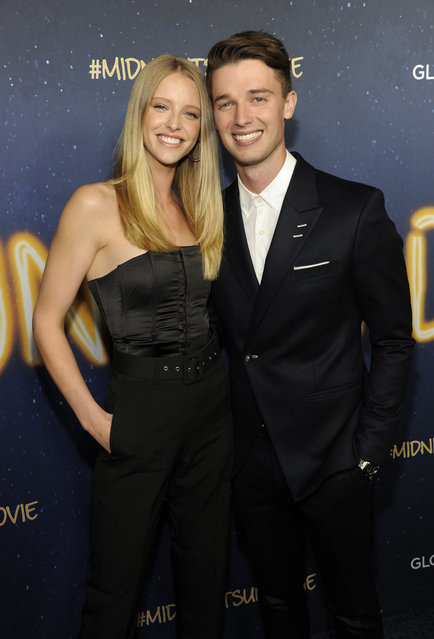 """Patrick Schwarzenegger, right, a cast member in """"Midnight Sun"""", poses with his girlfriend Abby Champion at the premiere of the film at the ArcLight Hollywood on Thursday, March 15, 2018, in Los Angeles. (Photo by Chris Pizzello/Invision/AP Photo)"""