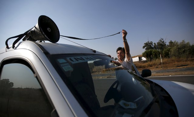 Projectionist Antonio Feliciano, 75, puts a megaphone on his van to announce a film in Castro Verde, Portugal August 31, 2013. (Photo by Rafael Marchante/Reuters)
