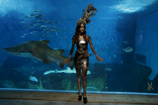 A model wearing a creation by Luis Benitez poses during an urban shoot as part of Andalucia de Moda (Andalusia Fashion) at the aquarium of Seville, southern Spain, November 11, 2015. (Photo by Marcelo del Pozo/Reuters)