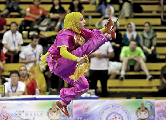 Iran's Hanieh Rajabi performs during the women's Daoshu competition at the 13th Wushu World Championships in Jakarta, Indonesia, Monday, November 16, 2015. (Photo by Tatan Syuflana/AP Photo)