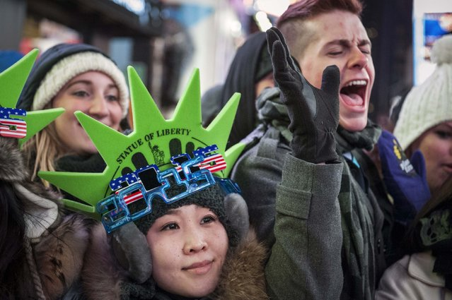 Revellers sport 2015 glasses while taking part in New Year's Eve celebrations in Times Square, New York December 31, 2014. (Photo by Stephanie Keith/Reuters)