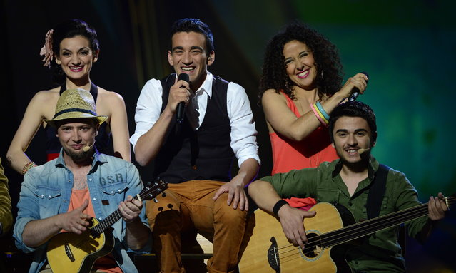 Malta's Gianluca (C) performs during the final of the 2013 Eurovision Song Contest in Malmo, Sweden, on May 18, 2013. (Photo by John MacDougall/AFP Photo)