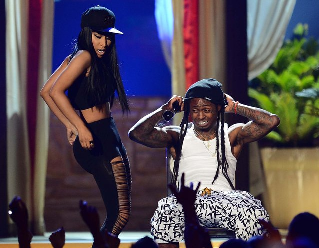 Nicki Minaj and Lil Wayne perform during the 2013 Billboard Music Awards. (Photo by Ethan Miller/Getty Images)