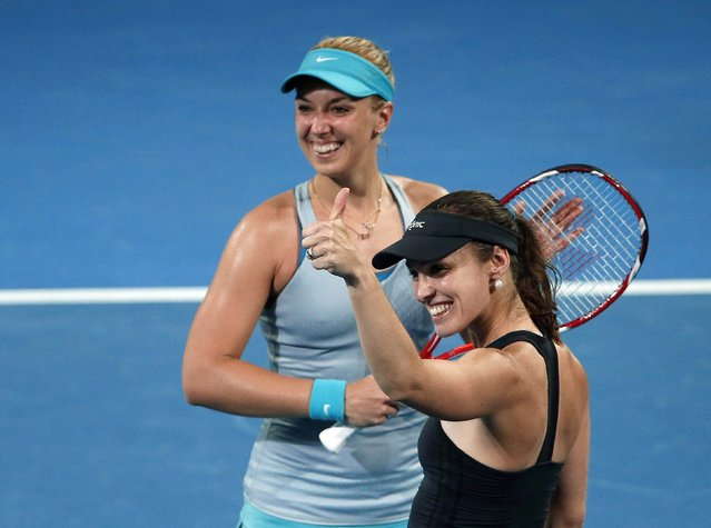 Martina Hingis (R) of Switzerland and Sabine Lisicki of Germany celebrate after winning the women's doubles final match at the Brisbane International tennis tournament in Brisbane, January 10, 2015. (Photo by Jason Reed/Reuters)