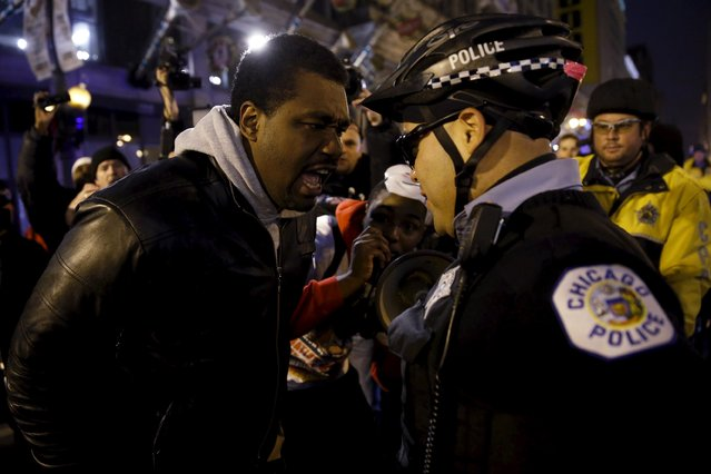Protestors including Quovadis Green (L) confront police during a demonstration in response to the fatal shooting of Laquan McDonald in Chicago, Illinois November 25, 2015. (Photo by Andrew Nelles/Reuters)