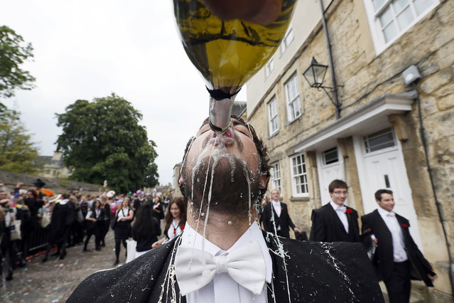 "A student from University College Oxford gets ""trashed"" after finishing his exams in Oxford, southern England June 7, 2013. Trashing is the practice at Oxford University where students have all manner of messy items thrown at them by their contemporaries after finishing their exams. (Photo by Stefan Wermuth/Reuters)"