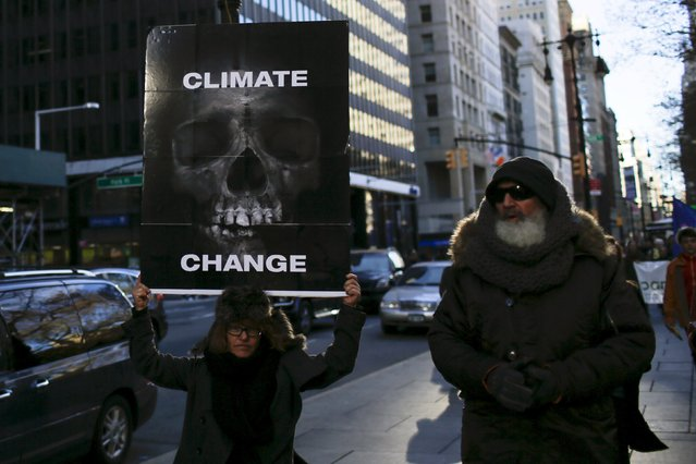 People take part in a protest about climate change around New York City Hall at lower Manhattan, New York, November 29, 2015, a day before the start of the Paris Climate Change Conference (COP21). (Photo by Eduardo Munoz/Reuters)