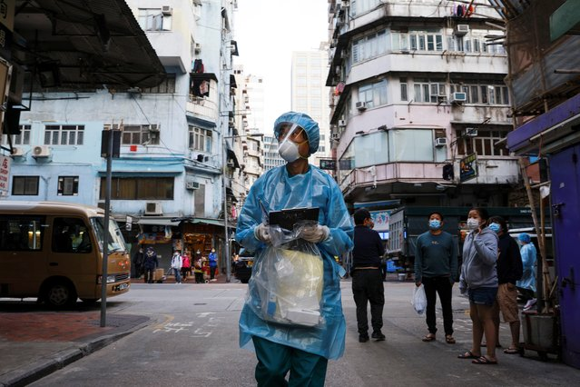 A medical worker in a protective suit walks near the residential area at Jordan, after the expand of mandatory coronavirus disease (COVID-19) testing, in Hong Kong, China on January 19, 2021. (Photo by Tyrone Siu/Reuters)