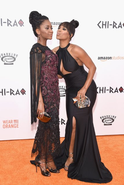 "Actors Teyonah Parris (L) and Michelle Mitchenor attend the ""CHI-RAQ"" New York premiere at Ziegfeld Theater on December 1, 2015 in New York City. (Photo by Gary Gershoff/Getty Images)"