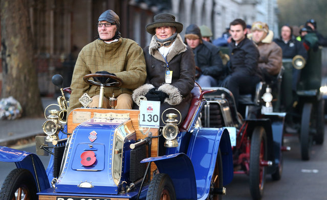 Participants drive their vintage car during the annual London to Brighton veteran car run in London, Britain November 6, 2016. (Photo by Neil Hall/Reuters)