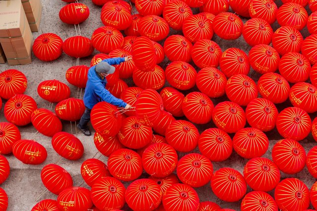 As the Spring Festival approaches, farmers usher in a busy production season of red lanterns in Xianju Hengxi Town, Ningbo City, east China's Zhejiang Province, 28 January 2021. (Photo by Rex Features/Shutterstock)