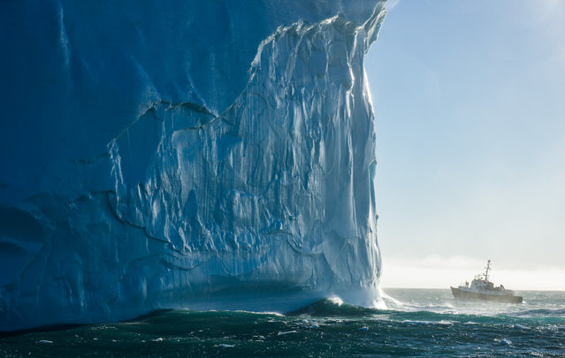 """""""Last bits of berg B15"""". The Hans Hansson, a 27-meter Antarctic expedition ship, approaches a small piece of iceberg B15 off the coast of South Georgia Island. Originally over 11,000 square kilometers and one of the largest icebergs ever recorded, berg B15 calved off the Ross Iceshelf in 2000 and has been melting ever since. Our captain estimated this piece to tower more than 100 meters above the ocean surface, but as much as 90% of an iceberg's volume is below the water! (Photo and caption by Eric Lew/National Geographic Traveler Photo Contest)"""