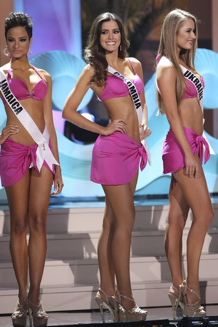 Miss Jamaica Kaci Fennell, Miss Colombia Paulina Vega, and Miss Ukraine Diana Harkusha onstage during The 63rd Annual Miss Universe Pageant at Florida International University on January 25, 2015 in Miami, Florida. (Photo by Alexander Tamargo/Getty Images)