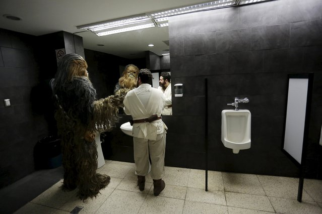 Cosplayers dressed as characters from the Star Wars movie series, stand in a bathroom during an event organised by Star Wars fan club Monterrey in Monterrey, Mexico, December 13, 2015. (Photo by Daniel Becerril/Reuters)
