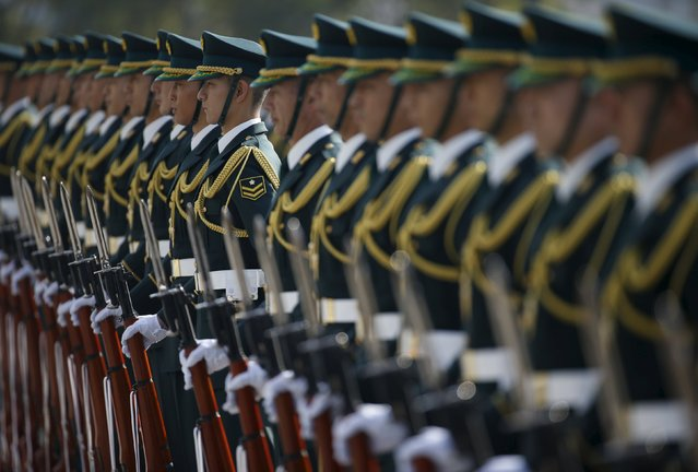 Members of Japan's Self-Defence Force's honour guard prepare for a ceremony for Prime Minister Shinzo Abe at the Defense Ministry in Tokyo December 16, 2015. (Photo by Issei Kato/Reuters)