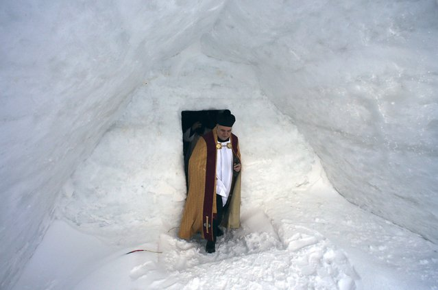 Romano Catholic archpriest Oskar Raicea leaves after the inaugural mass for a church made entirely from ice at Balea Lac resort in the Fagaras mountains January 29, 2015. (Photo by Radu Sigheti/Reuters)
