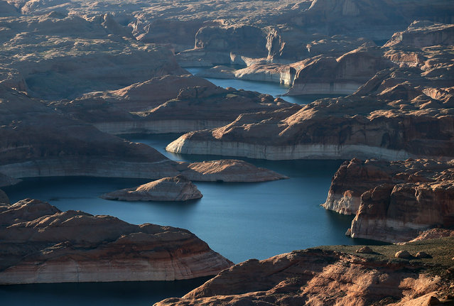 """A bleached """"bathtub ring"""" is visible on the rocky banks of Lake Powell on March 28, 2015 in Lake Powell, Utah. As severe drought grips parts of the Western United States, a below average flow of water is expected to enter Lake Powell and Lake Mead, the two biggest reservoirs of the Colorado River Basin. Lake Powell is currently at 45 percent of capacity, a recent study predicts water elevation there to be above 3,575 by September. The Colorado River Basin supplies water to 40 million people in seven western states. (Photo by Justin Sullivan/Getty Images)"""