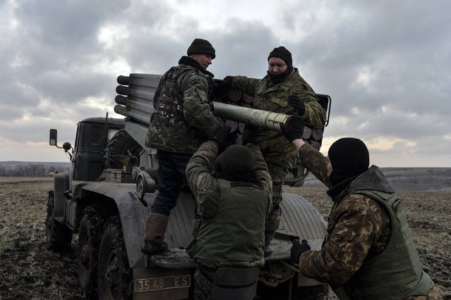 Ukrainian servicemen load Grad rockets before launching them towards pro-Russian separatist forces outside Debaltseve, eastern Ukraine February 8, 2015. (Photo by Alexei Chernyshev/Reuters)