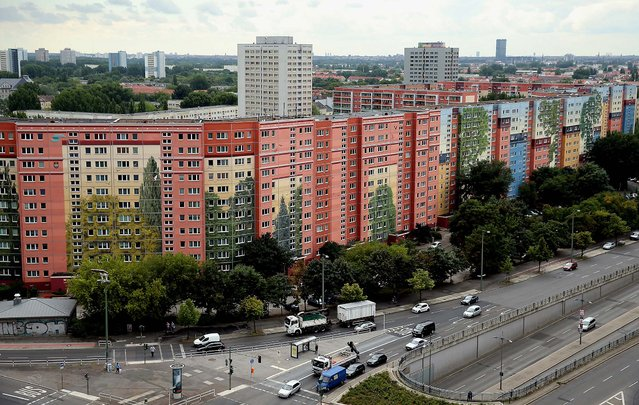 Cars drive past the Wohngenossenschaft Soldaritaet coop apartment buildings that are decorated with a 22,000 square meter mural. Citecreation has asked the Guinness Book of World Records to recognize the mural, which will be officially inaugurated on August 22, as the world's largest mural on an inhabited building.  (Photo by Sean Gallup/Getty Images)
