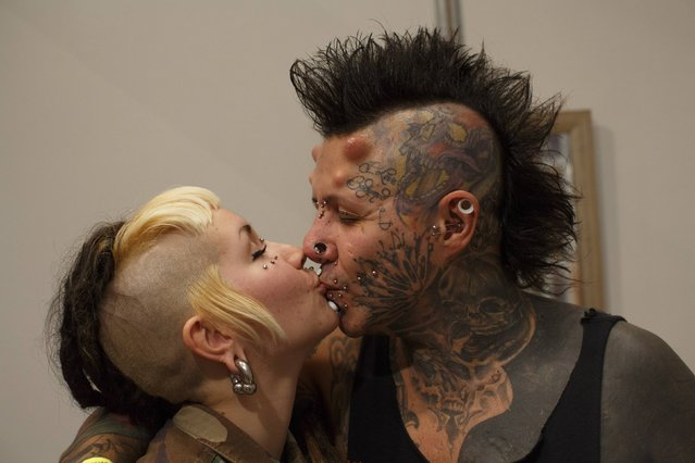 Pedrito Bodymod, 34, kisses his wife Angela during a tattoo convention in the Andalusian capital of Seville February 14, 2015. (Photo by Marcelo del Pozo/Reuters)
