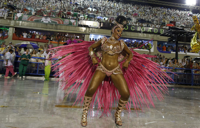 A performer from the Mangueira samba school dances during the Carnival parade at the Sambadrome in Rio de Janeiro, Brazil, Monday, February 16, 2015. (Photo by Leo Correa/AP Photo)