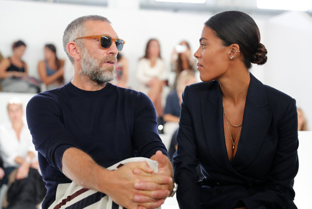 Actor Vincent Cassel and Tina Kunakey arrive at the Roberto Cavalli show during Milan Fashion Week Spring 2019 in Milan, Italy September 22, 2018. (Photo by Stefano Rellandini/Reuters)