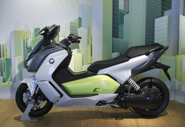 A BMW C evolution electric maxi-scooter is displayed in a showroom at the BMW Berlin motorcycle plant February 23, 2015. (Photo by Fabrizio Bensch/Reuters)