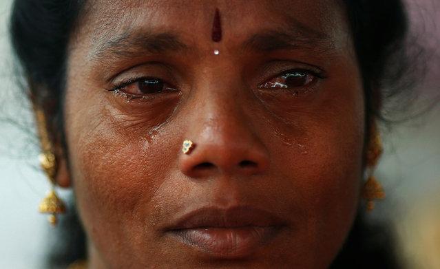 A supporter of Tamil Nadu Chief Minister Jayalalithaa Jayaraman cries after visiting the Jayalalithaa's burial site in Chennai, India, December 7, 2016. (Photo by Adnan Abidi/Reuters)