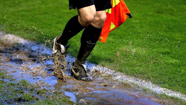 Assistant referee running though mud on the touchline during the Sky Bet League Two semi final, second leg match at The New Lawn Stadium, Nailsworth on Sunday, May 23, 2021. (Photo by Steven Paston/PA Images via Getty Images)