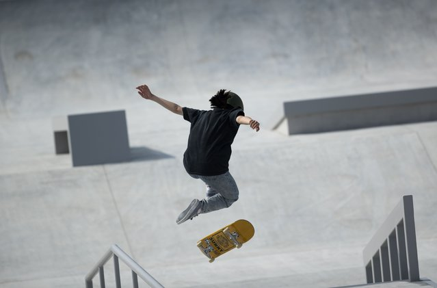 """Japanese skateboarder Miyu Sasaki performs in the women's street competition during a test event at the venue for the Olympic Games, which has been rescheduled to start in July, in Tokyo, Friday, May 14, 2021. The event dubbed """"Ready Steady Tokyo – Skateboarding"""" featured the sport that's included first time in the history of the Olympics. Only Japanese skateboarders participated in the test event. (Photo by Hiro Komae/AP Photo)"""