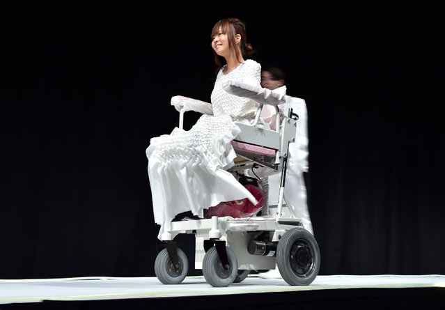 "Disabled model Ami Sano goes down the catwalk during rehearsals before modeling on the runway at a fashion show for the ""tenbo"" brand, designed by Japanese designer Takafumi Tsuruta, during the Tokyo Fashion Week's 2015-16 autumn/winter collection in Tokyo on March 18, 2015. (Photo by Yoshikazu Tsuno/AFP Photo)"