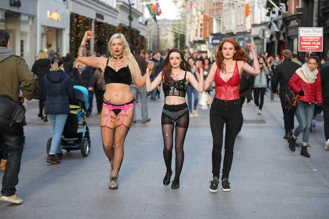 Protestors Stacie Ellen Murphy, Alanna Cassidy and Lena Seale walk in their Underwear on Grafton Street in Dublin, support of victims of sexual violence in Irerland. On Wednesday, November 16, 2018, in Dublin, Ireland. (Photo by PA Wire)