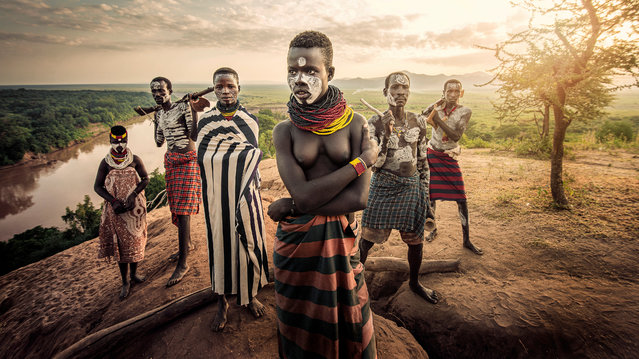 """""""People of the River"""". This is a Karo tribe family; father, mother, two sisters and two brothers. The tribe, who live along the Omo River in east Africa, incorporate rich symbolism into their rituals by using ornate body art, headdresses and body scarification to express beauty and significance. (Photo by Jatenipat Ketpradit/International Portrait Photographer of the Year)"""