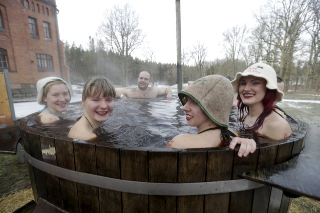 People enjoy a bath in hot kvass, a traditional fermented beverage made from rye bread, during the sauna marathon near Otepaa, Estonia, February 6, 2016. (Photo by Ints Kalnins/Reuters)