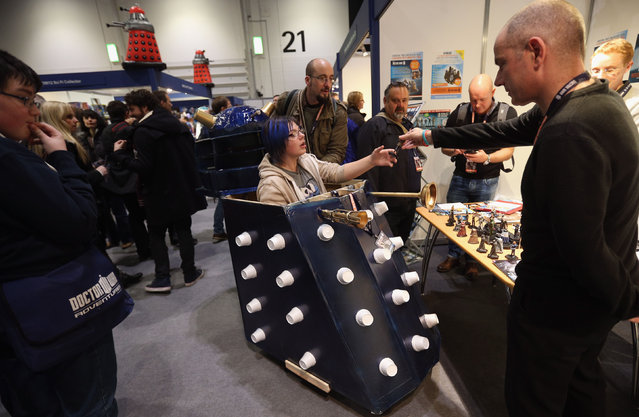 """A Doctor Who fan drives a mobility scooter decorated to resemble a Dalek at the """"Doctor Who 50th Celebration"""" event in the ExCeL centre on November 22, 2013 in London, England. (Photo by Oli Scarff/Getty Images)"""