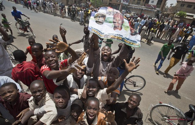 Supporters of opposition candidate Gen. Muhammadu Buhari's All Progressives Congress (APC) party celebrate what they said was the senatorial win in Kano Central district of APC candidate Rabiu Musa Kwankwaso, in Kano, northern Nigeria Monday, March 30, 2015. (Photo by Ben Curtis/AP Photo)