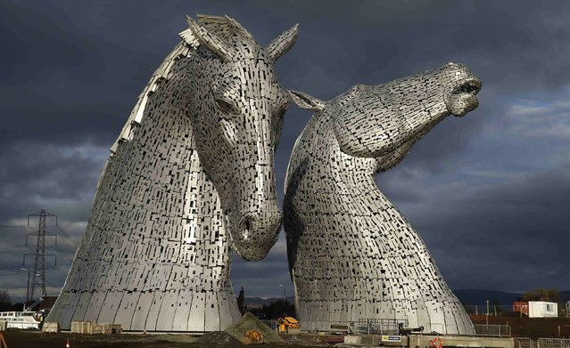 The Kelpies, two 30 meter high stainless-plate horse heads by sculpture Andy Scott are seen in Falkirk, Scotland November 27, 2013. (Photo by Russell Cheyne/Reuters)