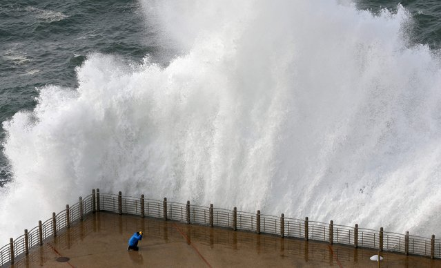 View of the waves at the new promenade of San Sebastian, Basque Country, northern Spain, 08 February 2016. The northern Spanish Atlantic coast is experiencing high tidal coefficients combine with warning winds and waves flooding that has set the red alarm. (Photo by Juan Herrero/EPA)