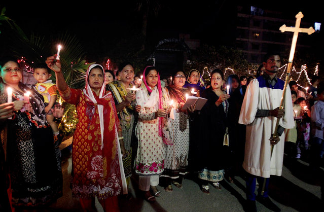 Pakistani Christians chant prayers during Easter service in Karachi, Pakistan, Sunday, April 5, 2015. Christians across the world are celebrating Easter, commemorating the day followers believe Jesus was resurrected in Jerusalem 2,000 years ago. (Photo by Fareed Khan/AP Photo)