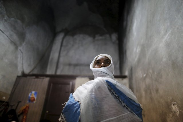 An Ethiopian Orthodox worshipper prays during the washing of the feet ceremony at the Ethiopian section of the Church of the Holy Sepulchre in Jerusalem's Old City April 9, 2015, ahead of Orthodox Easter. (Photo by Ammar Awad/Reuters)