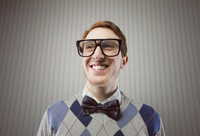 Nerd student making a funny smiling face. (Photo by Alamy Stock Photo)